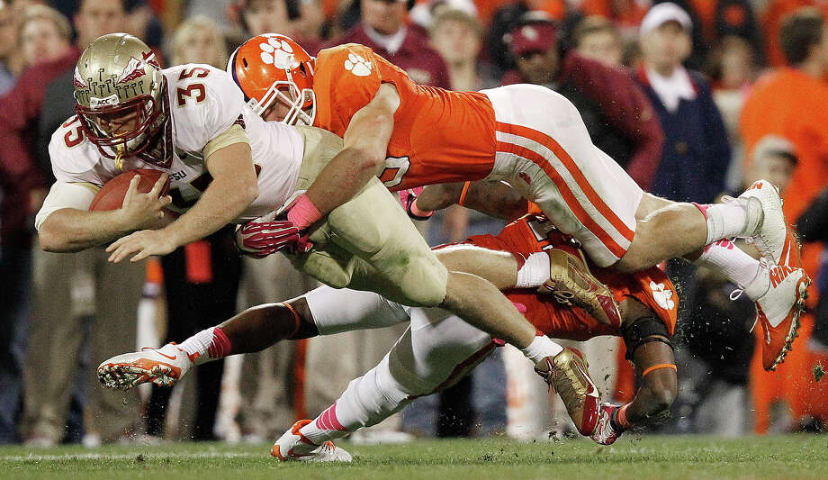 Florida State tight end Nick O'Leary (35) runs the ball against Clemson linebacker Spencer Shuey, top, and safety Travis Blanks, bottom, during the second half of an NCAA college football game, Saturday, Oct. 19, 2013, in Clemson, S.C. Photo: Mike Stewart, AP / AP