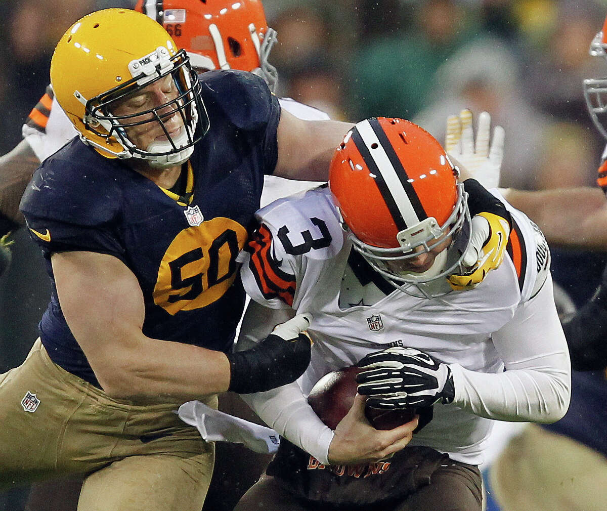 Green Bay Packers' A.J. Hawk (50) is called for a fface mask penalty as he tries to sack Cleveland Browns quarterback Brandon Weeden (3) during the second half of an NFL football game Sunday, Oct. 20, 2013, in Green Bay, Wis.