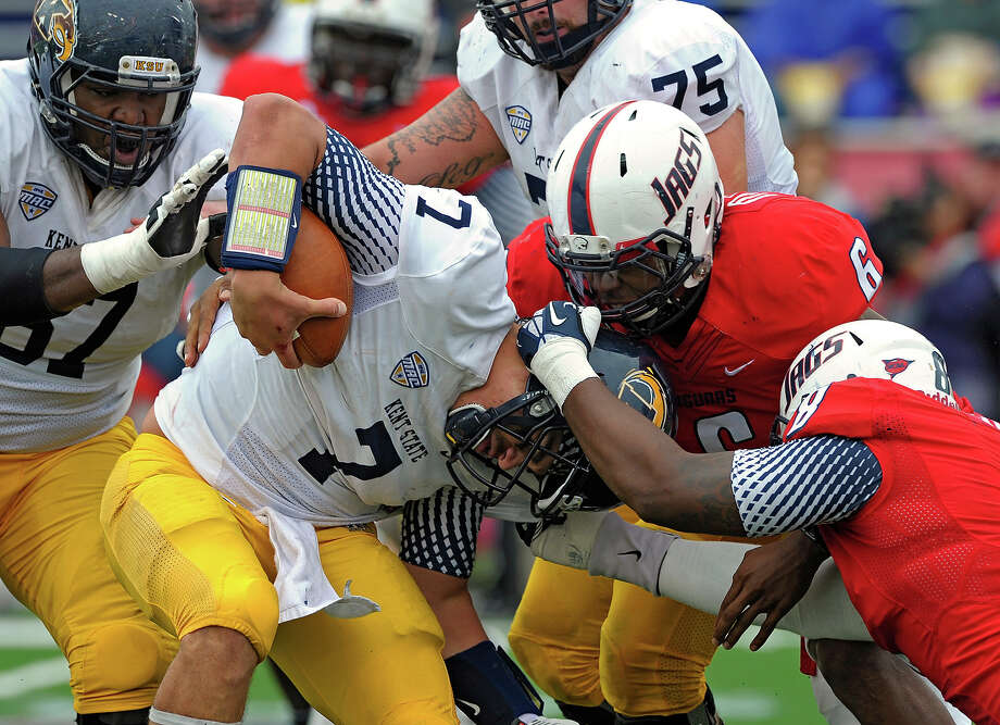Kent State quarterback David Fisher (7) is tackled by South Alabama linebacker Maleki Harris (6) and defensive end Pat Moore (8) in the second quarter of an NCAA college football game in Mobile, Ala., Saturday, Oct. 19, 2013. Photo: G.M. Andrews, AP / FR 35697AP