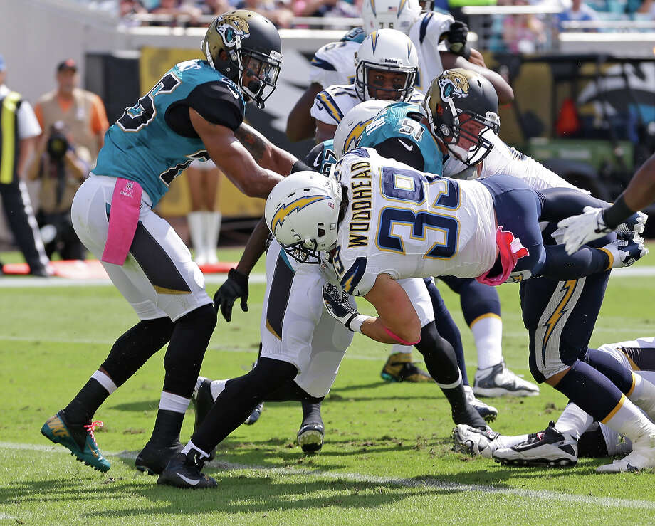 San Diego Chargers running back Danny Woodhead (39) dives past the Jacksonville Jaguars defense including middle linebacker Paul Posluszny (51) and free safety Josh Evans, left, for a 2-yard touchdown during the first half of an NFL football game in Jacksonville, Fla., Sunday, Oct. 20, 2013. Photo: John Raoux, AP / AP