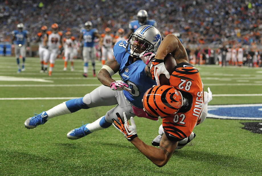 Cincinnati Bengals wide receiver Marvin Jones (82) catches a 12-yard touchdown reception as Detroit Lions cornerback Chris Houston (23) defends in the second quarter of an NFL football game against Sunday, Oct. 20, 2013, in Detroit. Photo: Jose Juarez, ASSOCIATED PRESS / AP2013