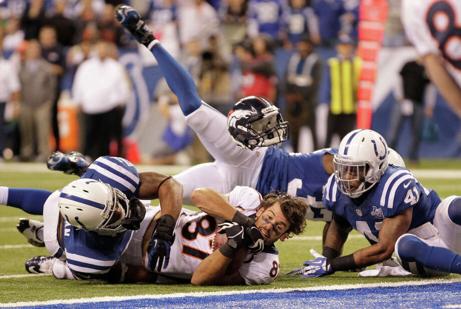 Denver Broncos wide receiver Eric Decker (87) loses his helmet as he makes a reception against Indianapolis Colts defense during the second half of an NFL football game, Sunday, Oct. 20, 2013, in Indianapolis. Photo: AJ Mast, ASSOCIATED PRESS / AP2013