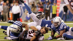 Denver Broncos wide receiver Eric Decker (87) loses his helmet as he makes a reception against Indianapolis Colts defense during the second half of an NFL football game, Sunday, Oct. 20, 2013, in Indianapolis.