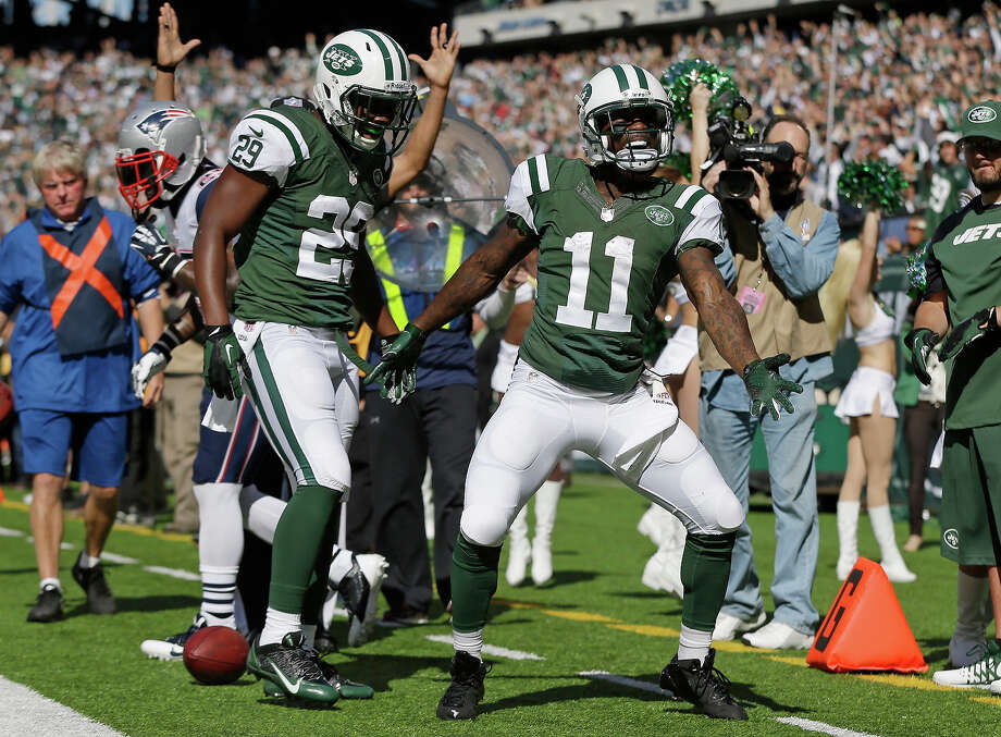 New York Jets wide receiver Jeremy Kerley (11) and Bilal Powell (29) celebrate a touchdown by Kerley during the first half of an NFL football game against the New England Patriots Sunday, Oct. 20, 2013 in East Rutherford. Photo: Seth Wenig, ASSOCIATED PRESS / AP2013
