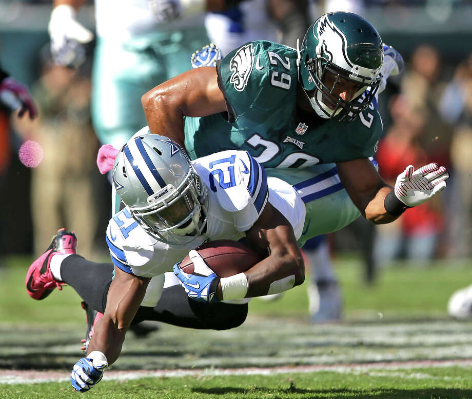 Dallas Cowboys running back Joseph Randle (21) is brought down by Philadelphia Eagles strong safety Nate Allen (29) during the first half of an NFL football game, Sunday, Oct. 20, 2013, in Philadelphia. Photo: Matt Rourke, ASSOCIATED PRESS / AP2013