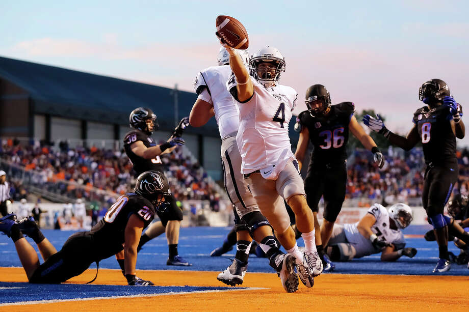Nevada running back Kendall Brock (4) scores a touchdown during the first half of an NCAA college football game against Boise State in Boise, Idaho, Saturday, Oct. 19, 2013. Photo: Otto Kitsinger, AP / FR171002 AP