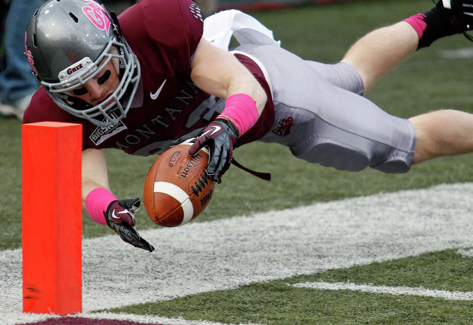 Montana wide receiver Cam Warren comes within inches of scoring a touchdown late in the fourth quarter against Cal Poly in an NCAA college football game in Missoula, Mont., Saturday, Oct. 19, 2013. Photo: Michael Albans, AP / FR35247 AP