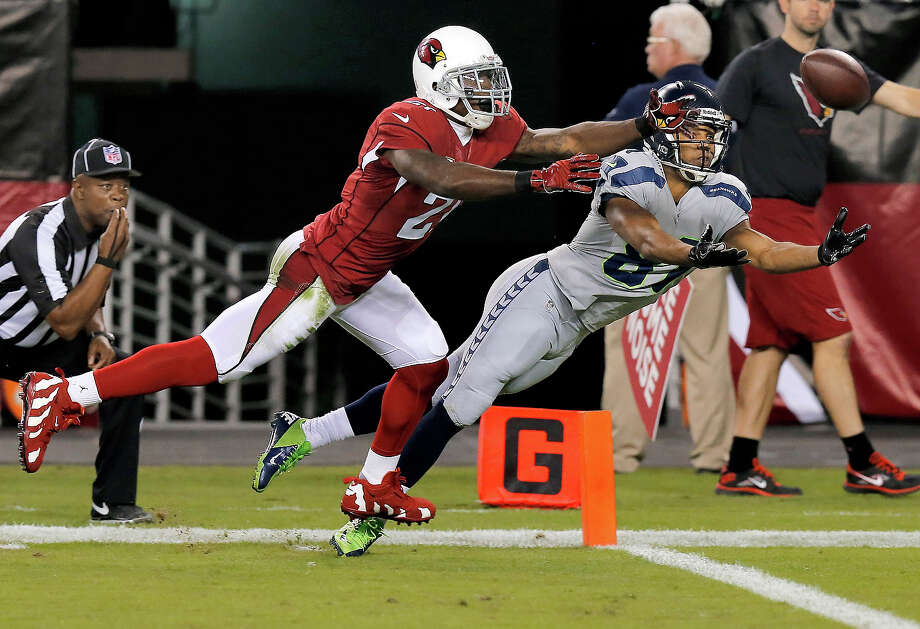 Seattle Seahawks wide receiver Golden Tate, right, can't catch the ball under pressure from Arizona Cardinals cornerback Patrick Peterson during the first half of an NFL football game, Thursday, Oct. 17, 2013, in Glendale, Ariz. Photo: Ross D. Franklin, ASSOCIATED PRESS / AP2013