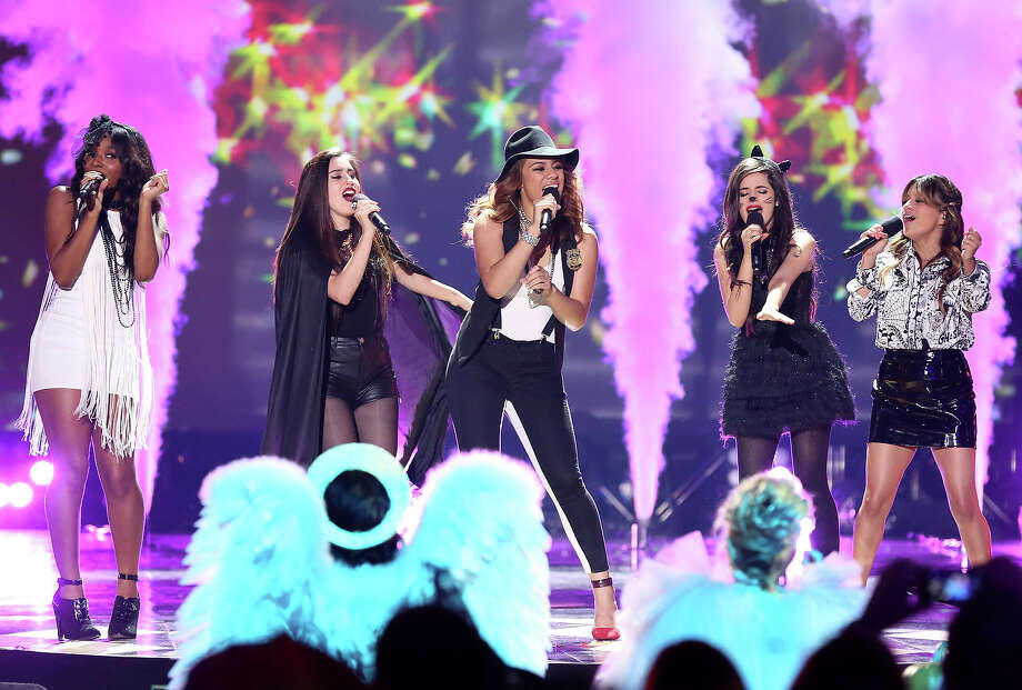 "From left, Normani Hamilton, Lauren Jauregui, Dinah Jane Hansen, Camila Cabello and Ally Brooke, of musical group Fifth Harmony, perform onstage at ""Hub Network's First Annual Halloween Bash"" on Sunday, Oct. 20, 2013, at the Barker Hanger in Santa Monica, Calif. The star-studded special will be broadcasted on the Hub Network on Saturday Oct. 26, 2013. Photo: Todd Williamson, Invision For The Hub Network / Invision2013"