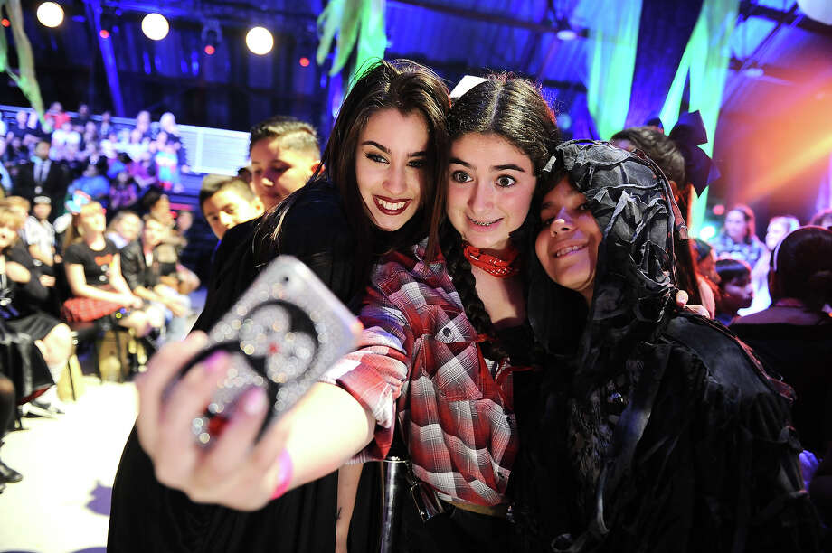 """Lauren Jauregui, left, of the musical group Fifth Element poses with guests at """"Hub Network's First Annual Halloween Bash"""" on Sunday, Oct. 20, 2013, at the Barker Hanger in Santa Monica, Calif. The star-studded special will be broadcasted on the Hub Network on Saturday Oct. 26, 2013. Photo: Jordan Strauss, Jordan Strauss/Invision/AP / Invision"""