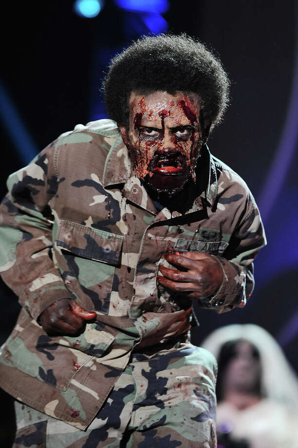 """Spooktacular"" nominee Christian Scott from Nebraska, appears onstage dressed as a Zombie Soldier at ""Hub Network's First Annual Halloween Bash"" on Sunday, Oct. 20, 2013, at the Barker Hanger in Santa Monica, Calif. The star-studded special will be broadcasted on the Hub Network on Saturday Oct. 26, 2013. Photo: Jordan Strauss, Jordan Strauss/Invision/AP / Invision"