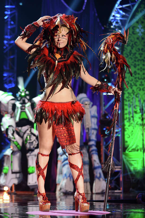 """Mad Genius"" nominee Athena Medina from Hawaii appears onstage dressed as Phoenix Warrior at ""Hub Network's First Annual Halloween Bash"" on Sunday, Oct. 20, 2013, at the Barker Hanger in Santa Monica, Calif. The star-studded special will be broadcasted on the Hub Network on Saturday Oct. 26, 2013. Photo: Jordan Strauss, Jordan Strauss/Invision/AP / Invision"