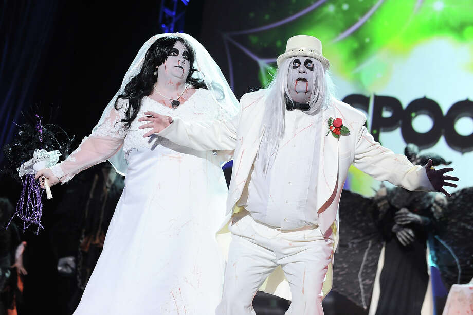 """Spooktacular"" nominees Rhonda Ladd, left, and Rick Downing Jr. from Arkansas, appear osntage dressed as Zombie Bride and Groom at ""Hub Network's First Annual Halloween Bash"" on Sunday, Oct. 20, 2013, at the Barker Hanger in Santa Monica, Calif. The star-studded special will be broadcasted on the Hub Network on Saturday Oct. 26, 2013. Photo: Jordan Strauss, Jordan Strauss/Invision/AP / Invision"