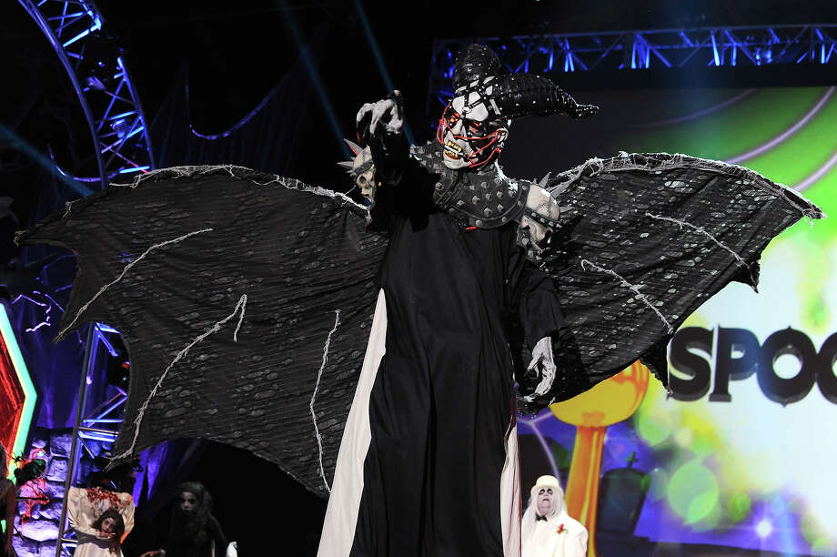 """Spooktacular"" nominee Curtis McGowan from West Virginia, appears onstage dressed as The Demon at ""Hub Network's First Annual Halloween Bash"" on Sunday, Oct. 20, 2013, at the Barker Hanger in Santa Monica, Calif. The star-studded special will be broadcasted on the Hub Network on Saturday Oct. 26, 2013. Photo: Jordan Strauss, Jordan Strauss/Invision/AP / Invision"