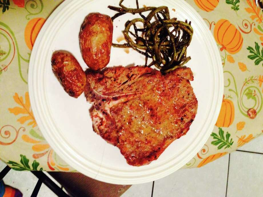 Porterhouse baked potatoes and asparagus with a balsamic glaze! Mmm also fresh tomato cucumber onion and fresh mozzarella salad. Submitted by Munchie Waddell Dewey