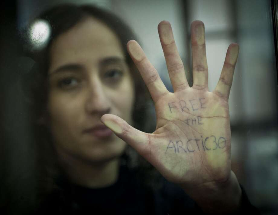 "Handout picture released by Greenpeace of Greenpeace International activist Faiza Oulahsen from the Netherlands showing her hand with written on ""Free the Artic 30"" during a bail hearing at the Murmansk Regional Court on October 18, 2013. Faiza Oulahsen is one of the 'Arctic 30' who are now in custody charged with piracy, punishable for up to 15 years in prison. Eleven Nobel Peace Prize winners have called on Russian President Vladimir Putin to ensure that ""excessive charges of piracy"" laid against 30 Greenpeace activists are dropped, Greenpeace said today. (ARCHIVEDMITRI SHAROMOV/AFP/Getty Images) Photo: DMITRI SHAROMOV, AFP/Getty Images"
