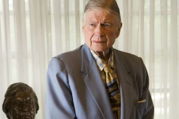 Bud Adams poses for a photo at his Houston home in 2009. Adams died on Oct. 21, 2013. He was 90 years old.