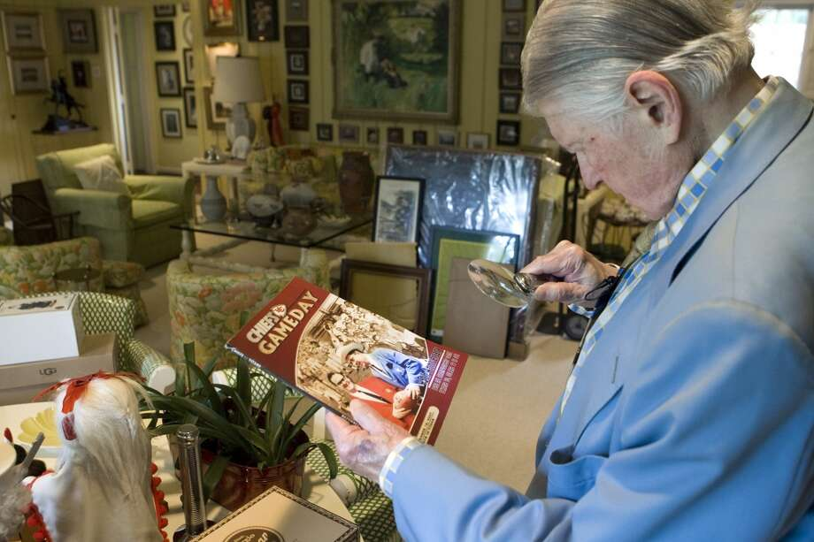 Bud Adams looks at a commemorative Kansas City Chiefs program, that marked the 45th anniversary of the 1962 American Football League Championship game. Photo: Brett Coomer, Houston Chronicle