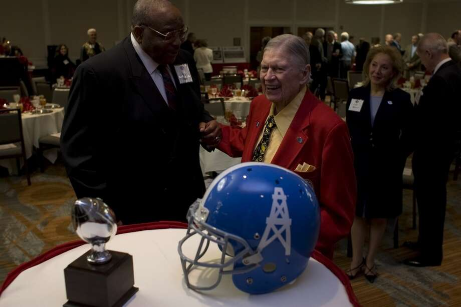 Bud Adams is greeted by former Oiler, Bob Kelly, before a reception for the 50th anniversary reunion of the Oilers 1960 and 1961 championship teams at the Westin Galleria Houston hotel in 2009. Photo: Johnny Hanson, Houston Chronicle