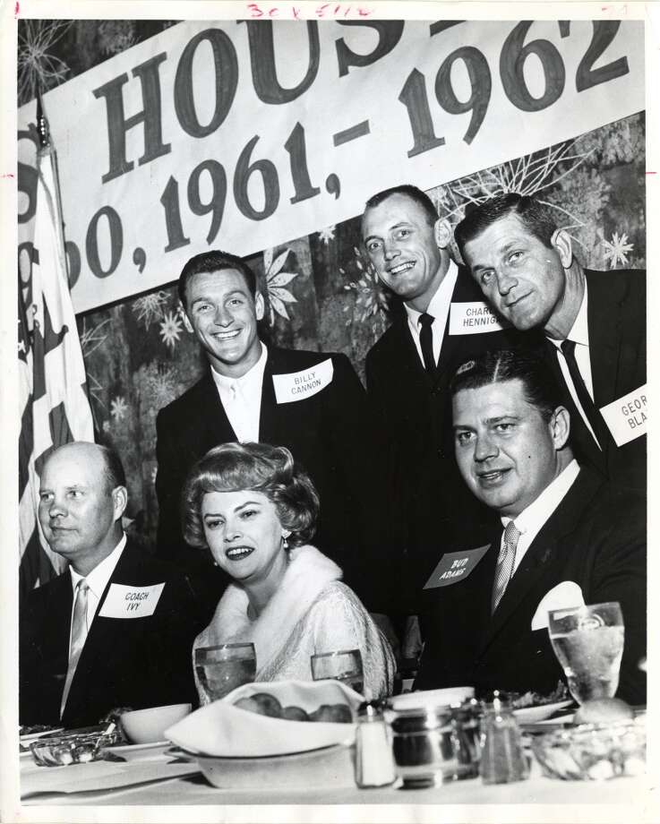 "Seated From left to right: Head coach Frank (Pop) Ivy, Mrs. K. S. Adams, Jr., owner-president K. S. Adams, Jr. (Kenneth S ""Bud"" Adams Jr.),  Standing from left to right: halfback Billy Cannon, flankerback Charlie Hennigan, and quarterback George Blanda at the Oilers Appreciation dinner in 1962. Photo: Al Startzman, Chronicle File Photo"