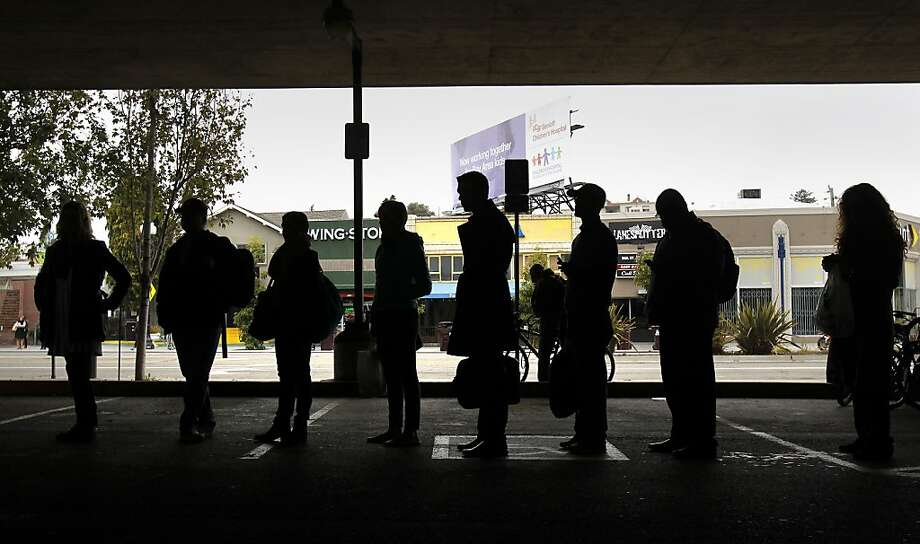 Commuters line up at a casual-carpool site near Grand Avenue in Oakland to catch a ride to S.F. as the BART strike drags on. Photo: Brant Ward, The Chronicle