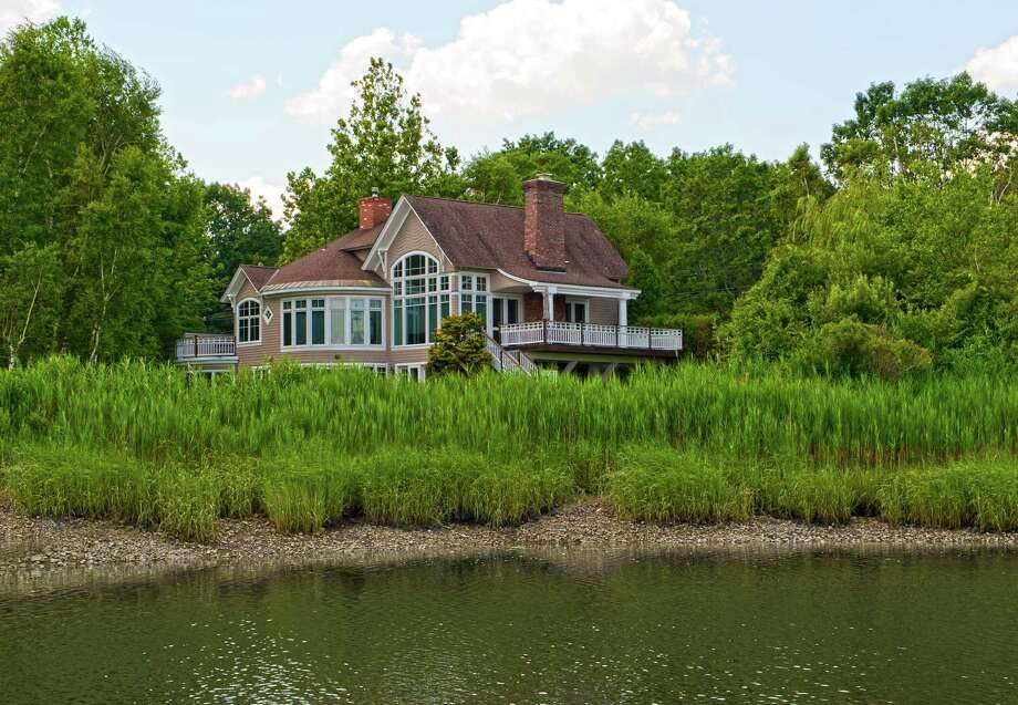The house at 19 Duck Pond Road is on the market for $2.4 million. Photo: Contributed Photo / Westport News contributed