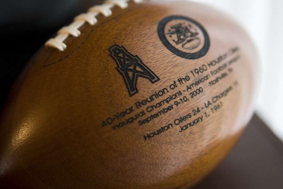 A commemorative wooden football marking a reunion of the original American Football League champion Houston Oilers is shown in owner Bud Adams' home. Photo: Brett Coomer, Houston Chronicle