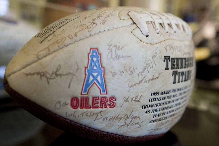 An Oilers logo adorns a Tennessee Titans autographed by the 1999 team. Photo: Brett Coomer, Houston Chronicle