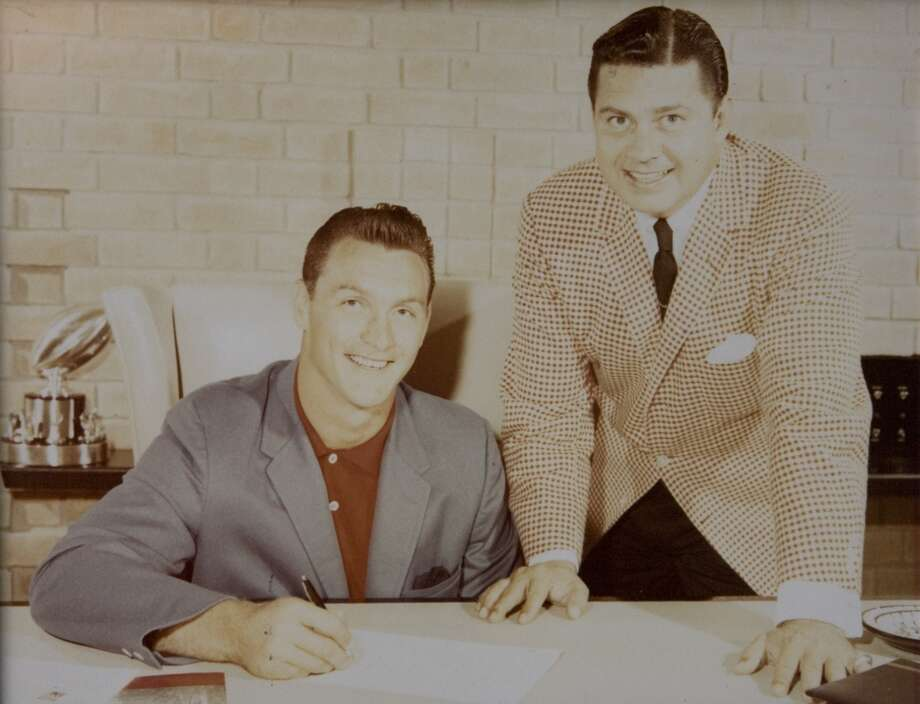 Bud Adams poses for a photo while signing Heisman Trophy winner Billy Cannon from LSU in this 1960 photo. Photo: Photo Courtesy Bud Adams