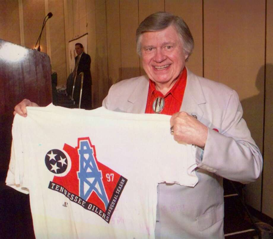 In 1997, Bud Adams shows off a T-shirt with the new logo for the Oilers, whom he had just moved to Nashville, Tenn. Photo: Houston Chronicle File Photo