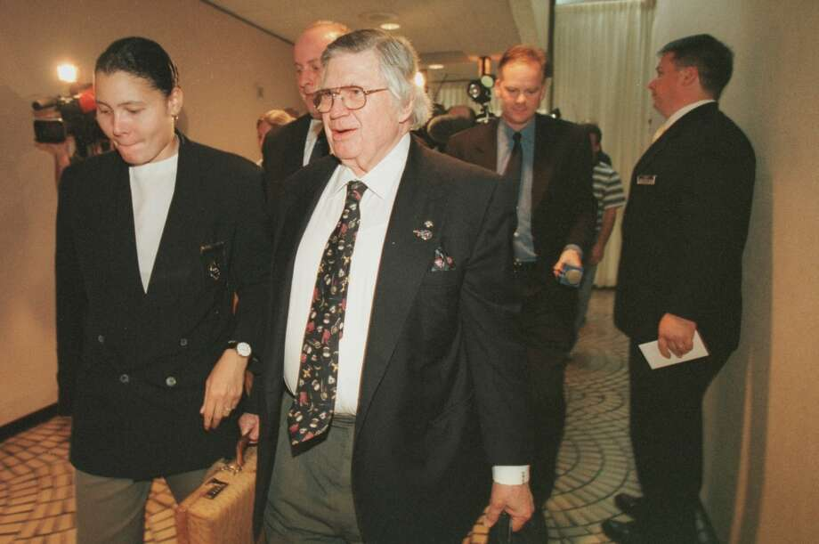 In this Oct. 5, 1999 photo, Bud Adams, in front with briefcase, is seen at the Hyatt Regency Atlanta, attended by security and followed by the media, where the NFL's expansion committee met. Photo: Houston Chronicle File Photo
