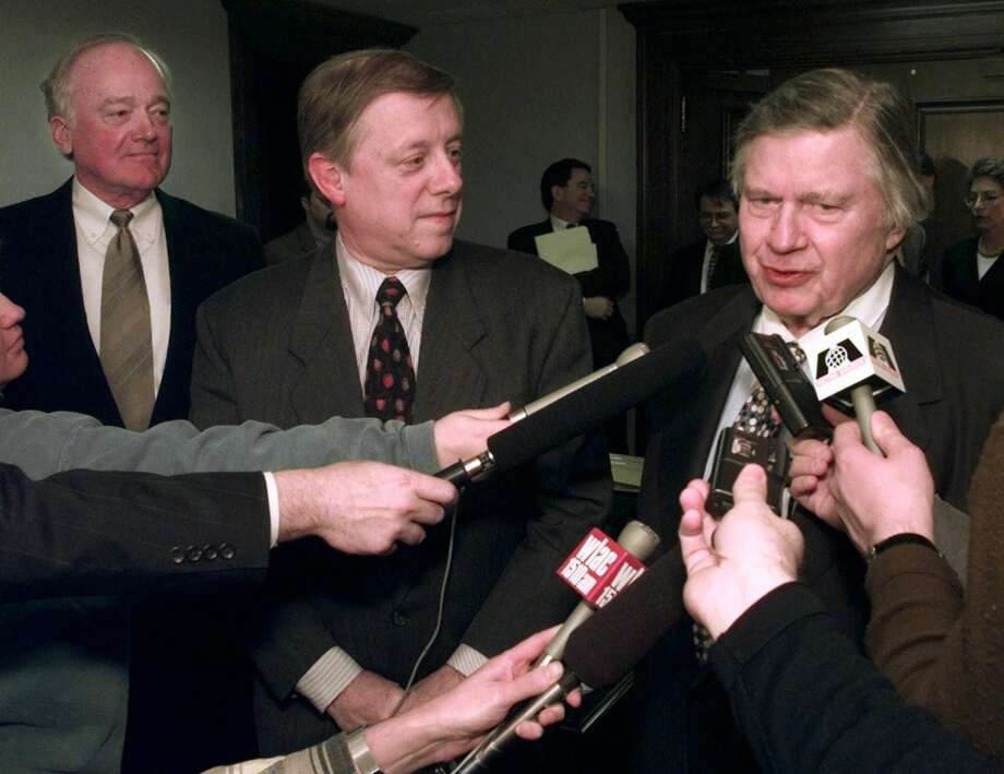 Bud Adams, right, answers questions with Vanderbilt Chancellor Joe Wyatt, far left, and Nashville Mayor Phil Bredesen after a meeting in Bredesen's office in Nashville, Tenn., on Tuesday, March 3, 1998. The group announced a tentative agreement that will let the Oilers play their 1998 home games at Vanderbilt's football stadium. Photo: Mark Humphrey, Associated Press