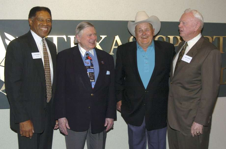 Elvin Bethea, Bud Adams Bum Phillips and Bill Yeoman share a moment at the Texas Sports Hall of Fame in 2004. Photo: Associated Press