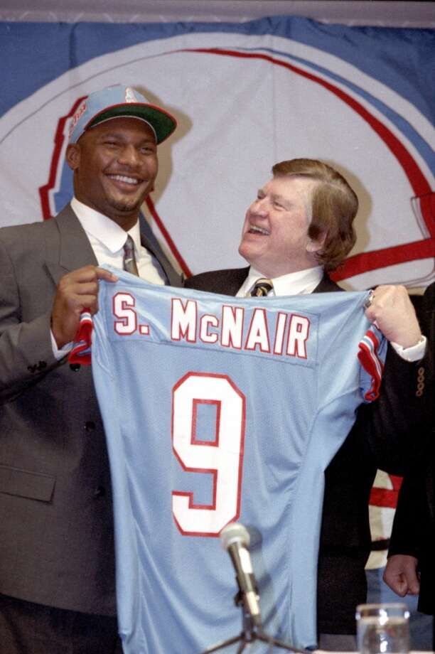 Oilers owner Bud Adams, right, presented Steve McNair with his jersey after flying him to Houston after the 1995 draft. Photo: Howard Castleberry, Houston Chronicle File Photo