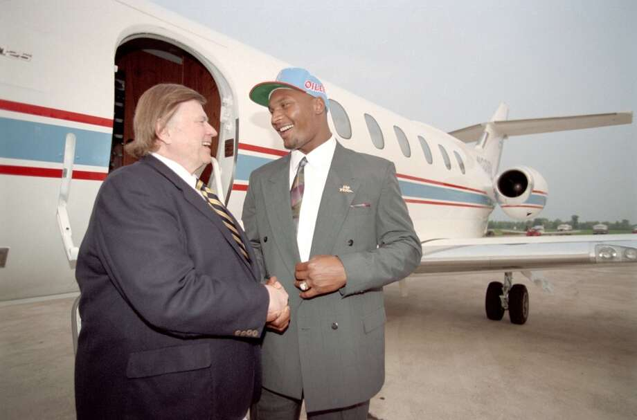 Bud Adams with Steve McNair after the 1995 draft. Photo: Howard Castleberry, Houston Chronicle File Photo