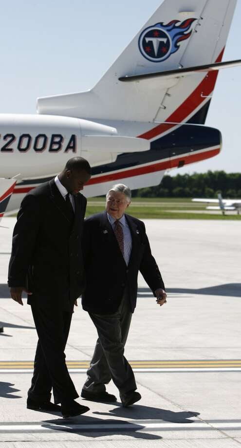 Bud Adams, right with Vince Young after Young deplaned off of Adam's private jet as the two head for a press conference at the Sugar Land Regional Airport, one day after Young was drafted by the Titans in 2006. Photo: Karen Warren, Houston Chronicle