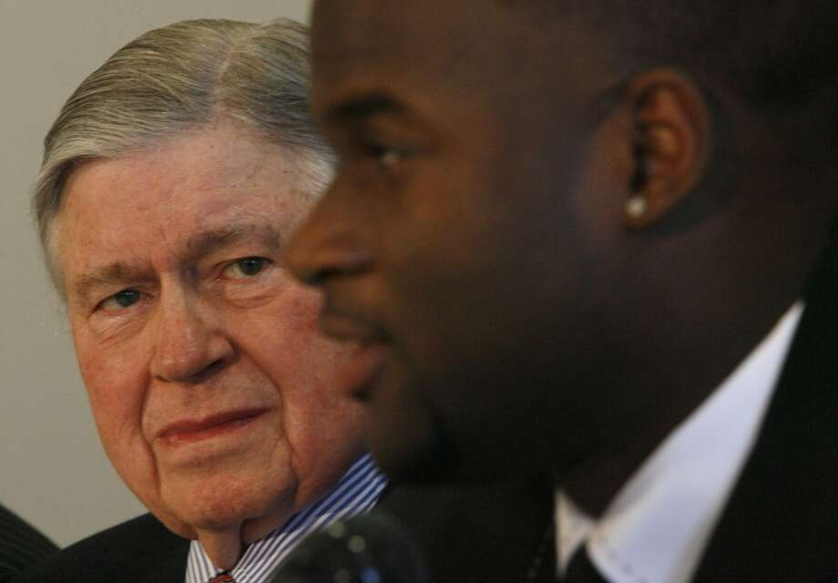 Bud Adams and Vince Young hold a press conference at the Sugar Land Regional Airport, one day after Young was drafted by the Titans. Photo: Karen Warren, Houston Chronicle