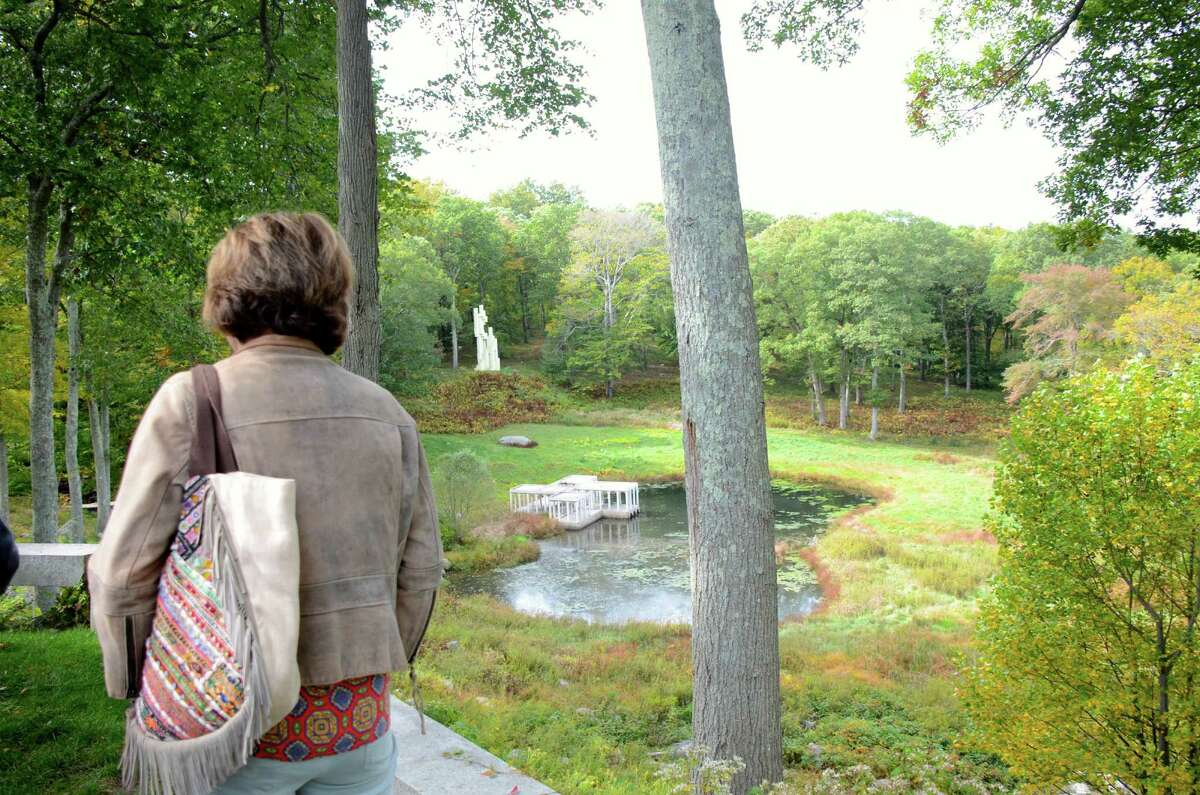 A visitor looks down at the Lake Pavilion and the Lincoln Kirstein Tower during the second Community Day at Philip Johnson's Glass House held on October 9, 2013, in New Canaan, Conn.