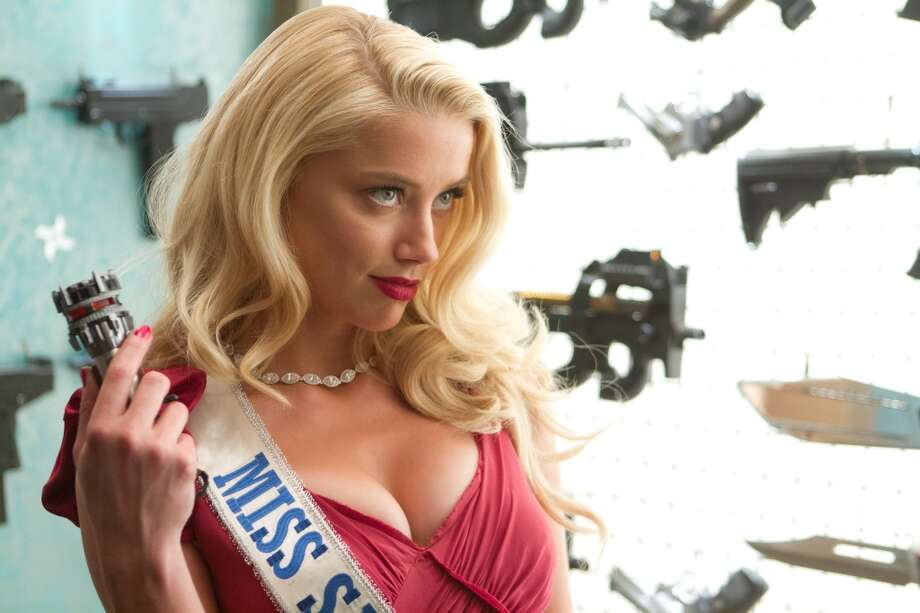 "Amber Heard in a scene from ""Machete Kills."" Photo: Rico Torres, Associated Press"