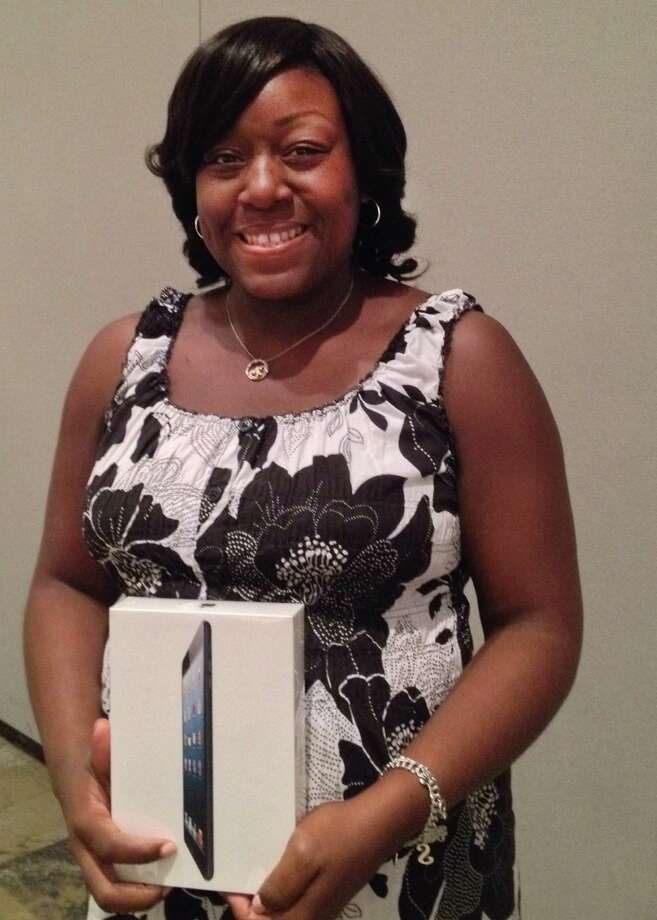 Shukella Price, Dekaney High School teacher of the year, won an iPad during a drawing at the Lake Houston Area Chamber of Commerce Teacher of the Year Luncheon. Photo: Photo Courtesy Of The Spring Independent School District