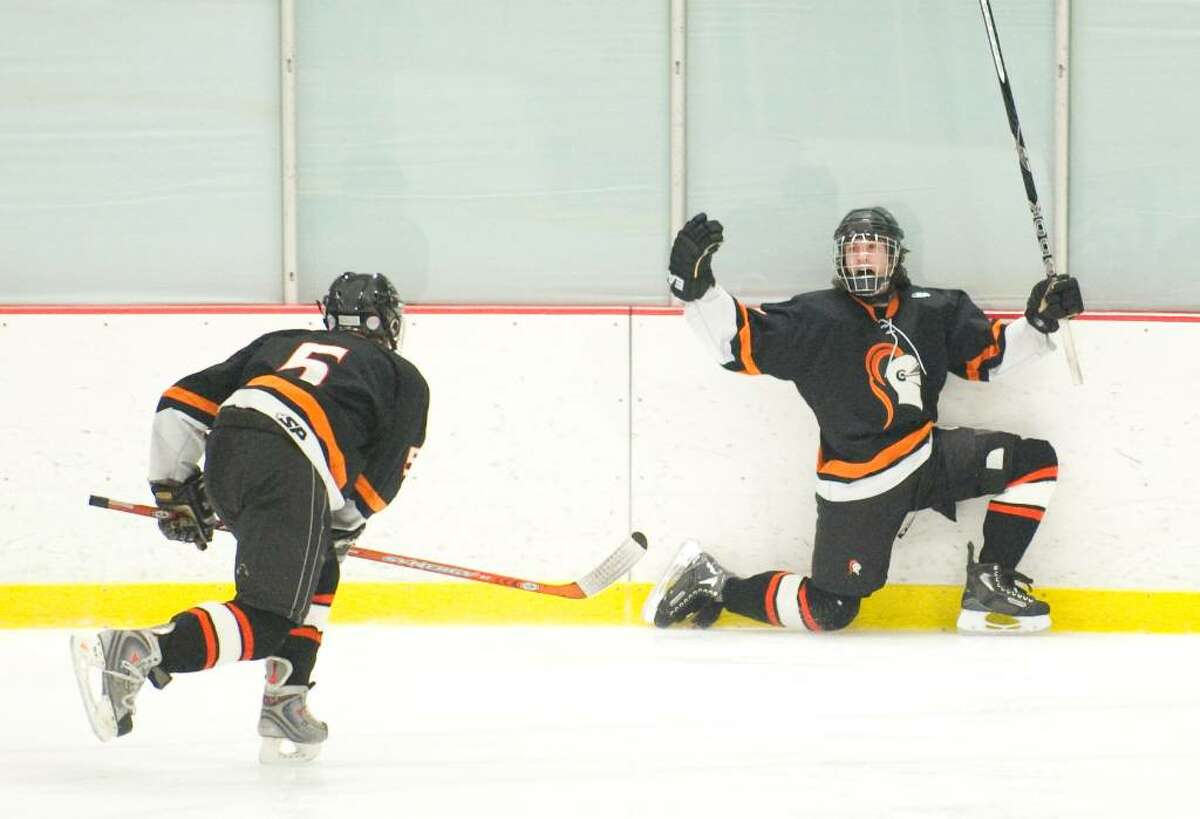 Stamford's Preston Rogers, right, celebrates after scoring a hat trick during an FCIAC hockey game at Terry Conners Rink in Stamford, Conn. on Wednesday, Jan. 27, 2010. Stamford High School defeated Trinity Catholic High School 4-3 in overtime.