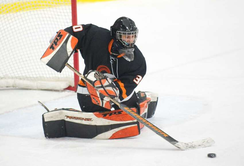 Stamford's Jon Tenca makes save during an FCIAC hockey game at Terry Conners Rink in Stamford, Conn. on Wednesday, Jan. 27, 2010. Stamford High School defeated Trinity Catholic High School 4-3 in overtime.