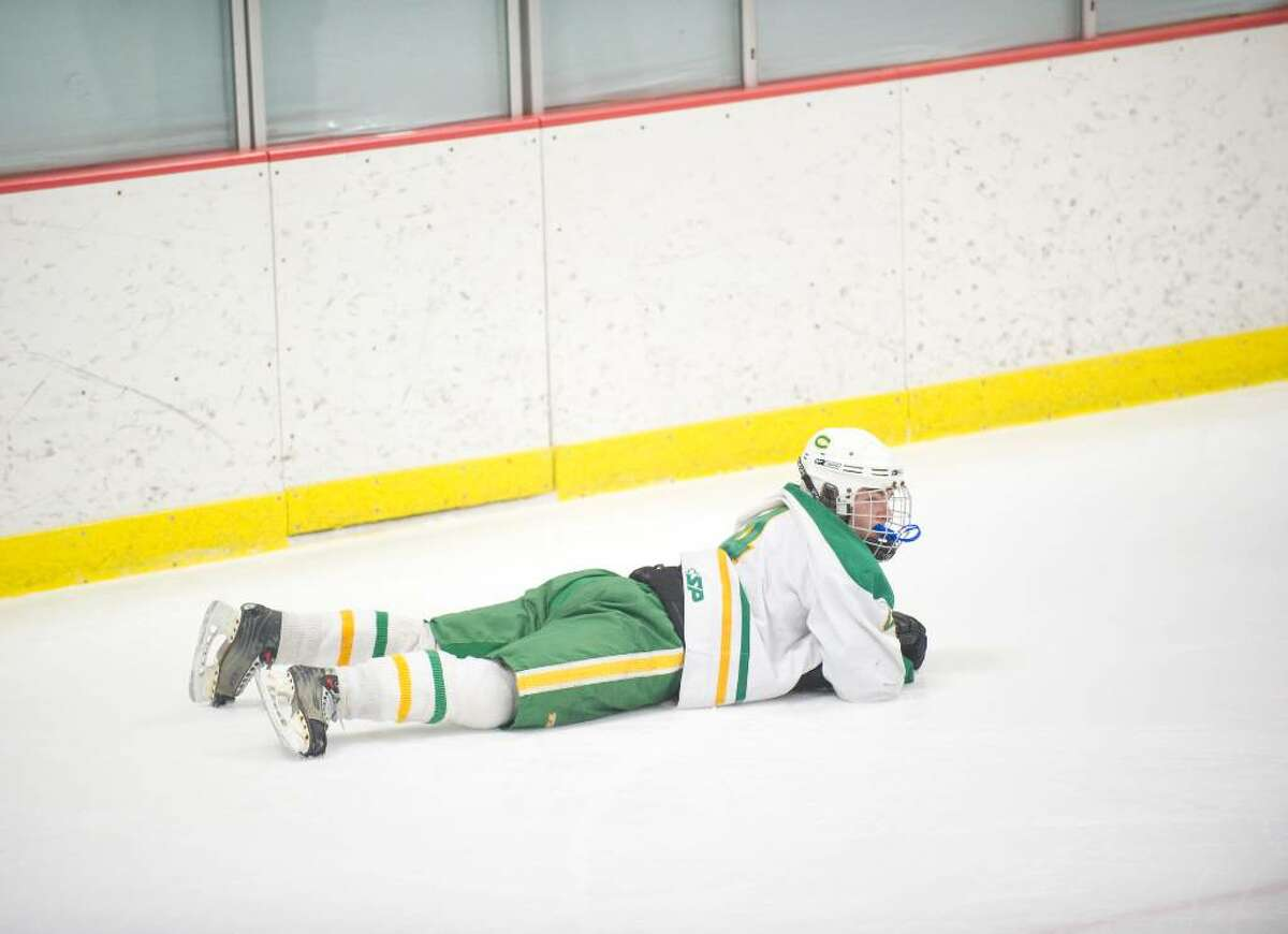 Trinity's Eric Bean lies on the ice after his team lost to Stamford in overtime during an FCIAC hockey game at Terry Conners Rink in Stamford, Conn. on Wednesday, Jan. 27, 2010. Stamford High School defeated Trinity Catholic High School 4-3 in overtime.