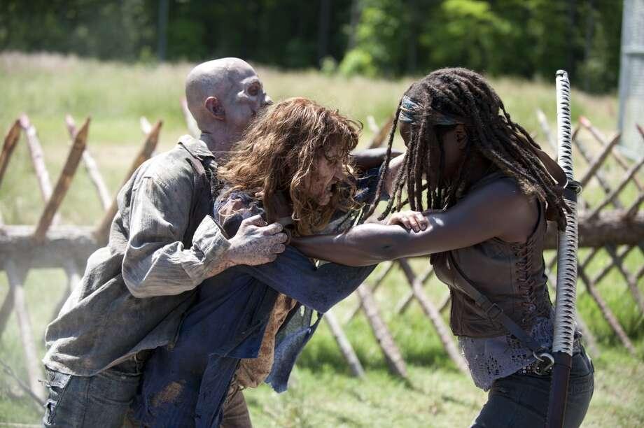 Walker and Michonne (Danai Gurira) - The Walking Dead _ Season 4, Episode 2 - Photo Credit: Gene Page/AMC