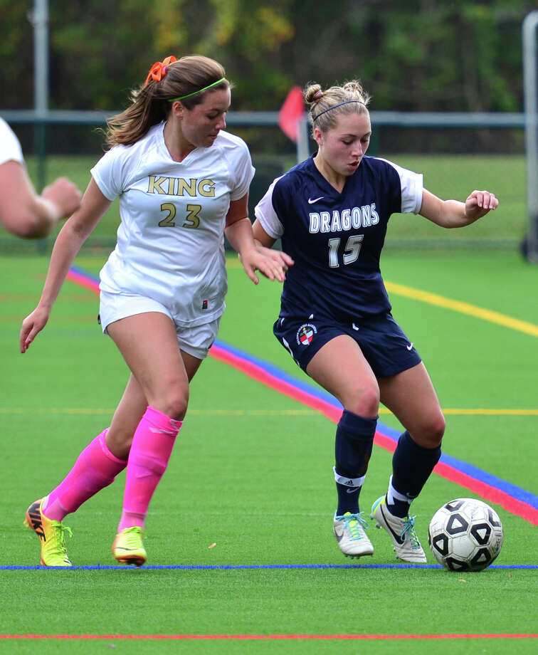 Greens Farms Academy's Olivia Lennon of Westport, right, protects the ball from a King opponent during the Dragons 2-0 victory Oct. 19. Photo: Contributed Photo / Westport News