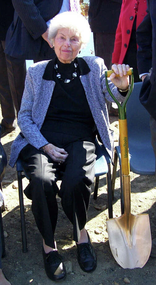 Philanthropist Mimi Levitt poses with a shovel during the ceremonial groundbreaking ceremony Monday for a new Levitt Pavilion performance center on the banks of the Saugatuck River. Photo: Anne M. Amato / Westport News contributed