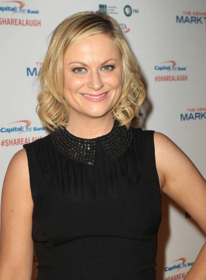 Amy Poehler arrives at 16th Annual Mark Twain Prize presented to Carol Burnett at the Kennedy Center on Sunday, Oct. 20, 2013 in Washington, D.C. (Photo by Owen Sweeney/Invision/AP) Photo: Associated Press
