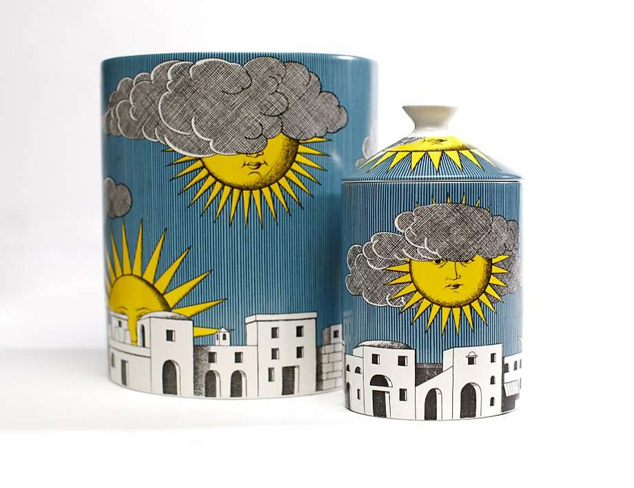Scented candles in reusable ceramic vessels introduce Fornasetti's new home fragrance with images from Sole di Capri. Photo: Russell Yip, The Chronicle