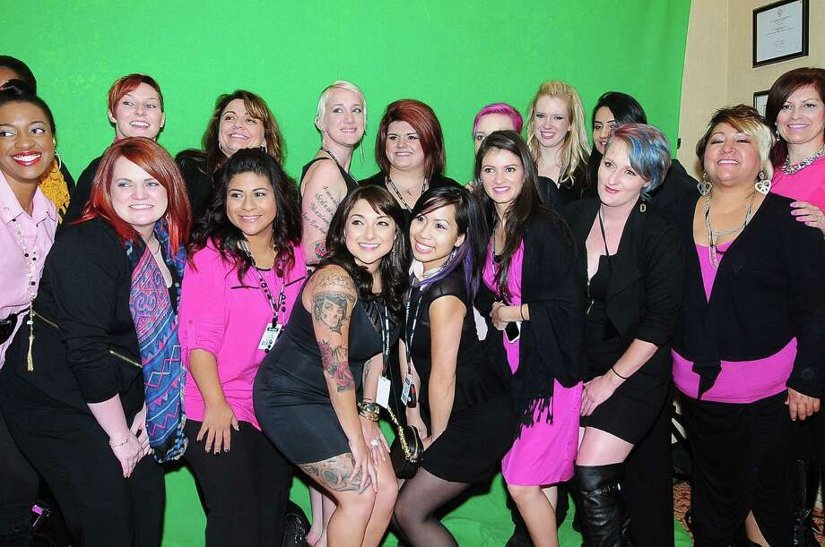 The Paul Mitchell School helped with the hair and make-up for the models in the fashion show and take a group photo during the North Cypress Medical Center Project Pink 2013 event benefiting the Houston affiliate of Susan G. Komen for the Cure on Oct. 19. Photo: © Tony Bullard 2013, Tony Bullard / © Tony Bullard & the Houston Chronicle