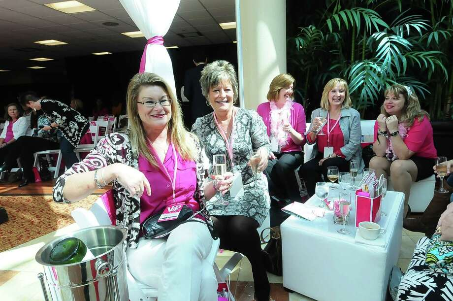 L-R: Mary Papageorge and Susan Huhn  share some wine as Janet Grayson,  Pam Mendez and Lori Landry  socialize during the North Cypress Medical Center Project Pink 2013 event benefiting the Houston affiliate of Susan G. Komen for the Cure on Oct. 19. Photo: © Tony Bullard 2013, Tony Bullard / © Tony Bullard & the Houston Chronicle
